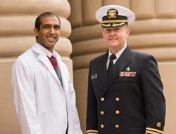 Third- year student Braveen Ragunanthan with award presenter Cmdr. Ray Ford.