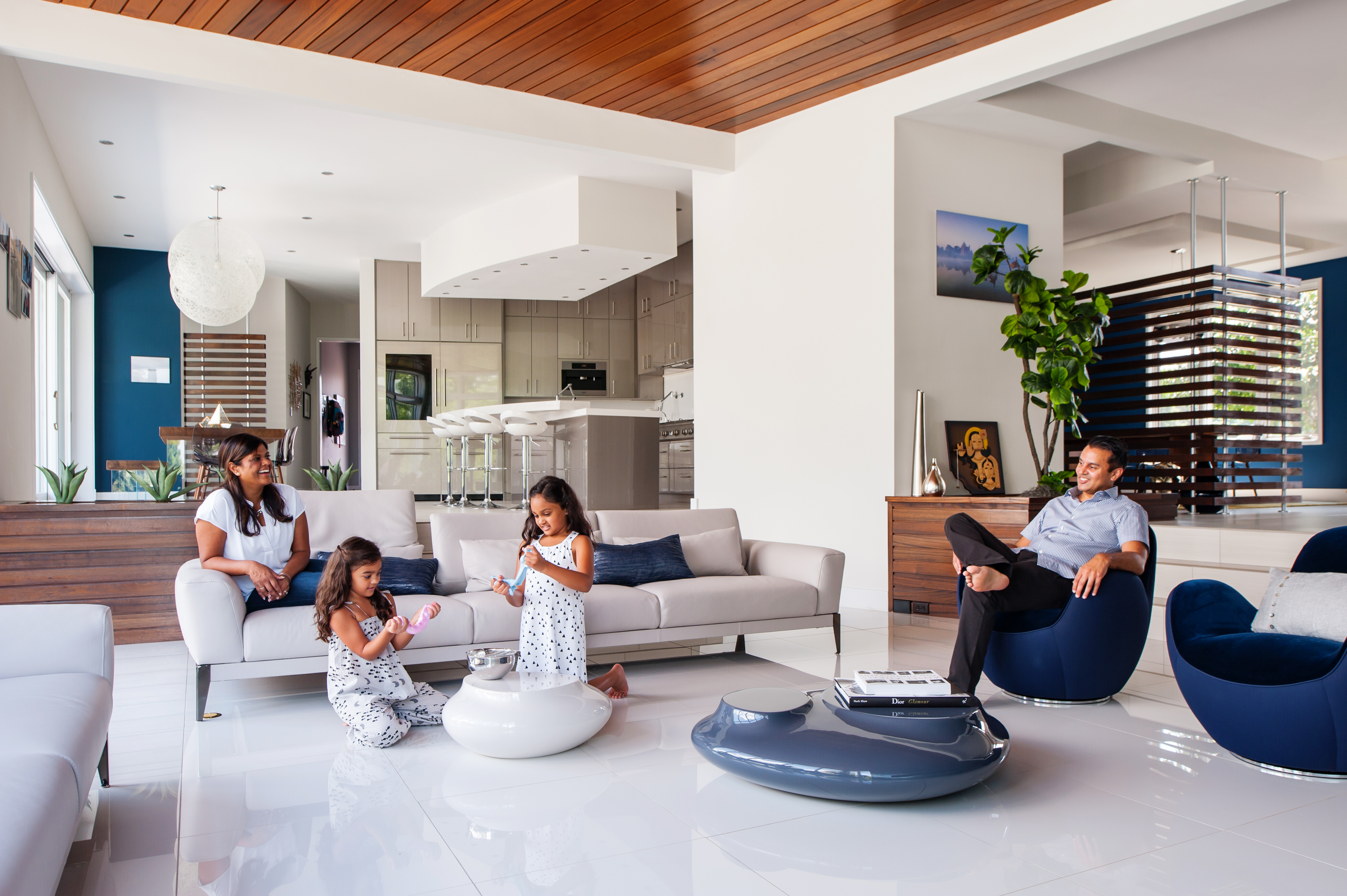 Neema and Mitesh Amin, with daughters Kirin and Riya, relax in their contemporary home in Chester, Virginia. Photo by Ansel Olson (B.F.A.'96/A: M.F.A.'02/A)